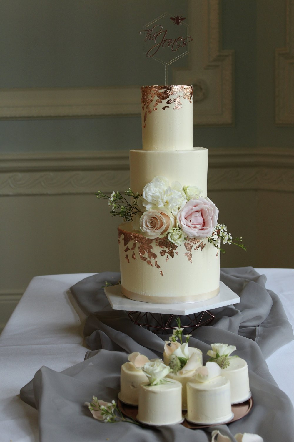 Modern, minimal buttercream wedding cake with copper accents by Yolk www.cakesbyyolk.com