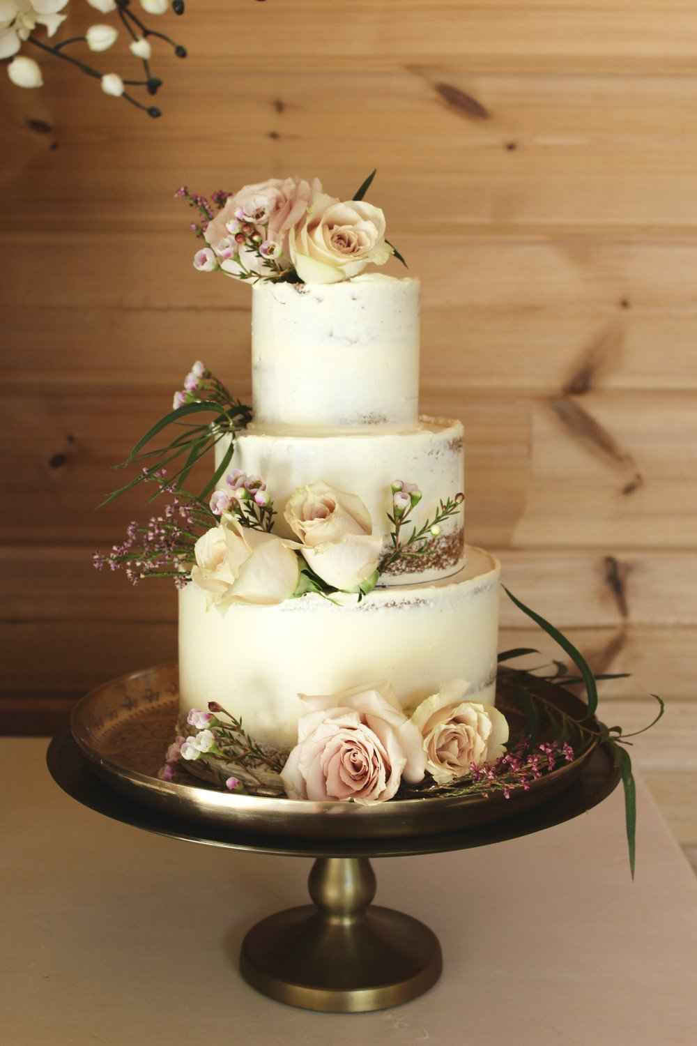 Semi-naked blush and burgundy wedding cake
