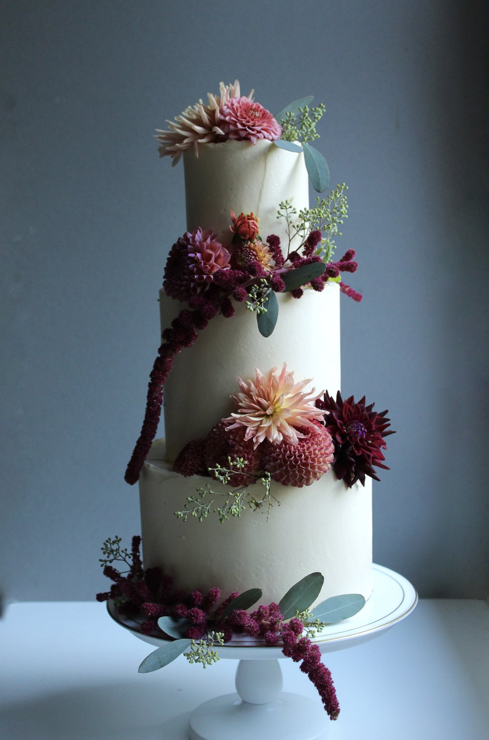 Burgundy and blush three tier smooth buttercream wedding cake