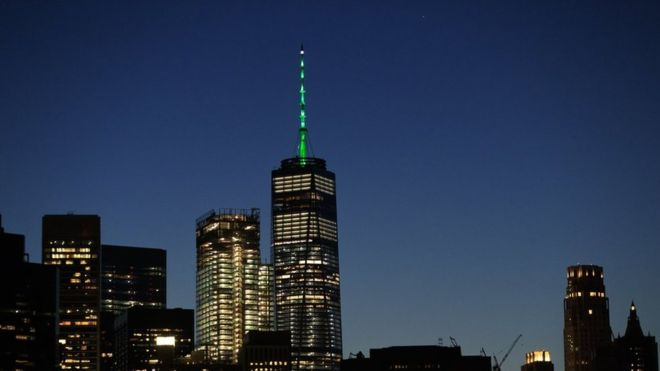 A green glow on the outside of US buildings usually means it's St Patrick's Day. But on Thursday night, green stood not for Irish heritage, but for the environment.