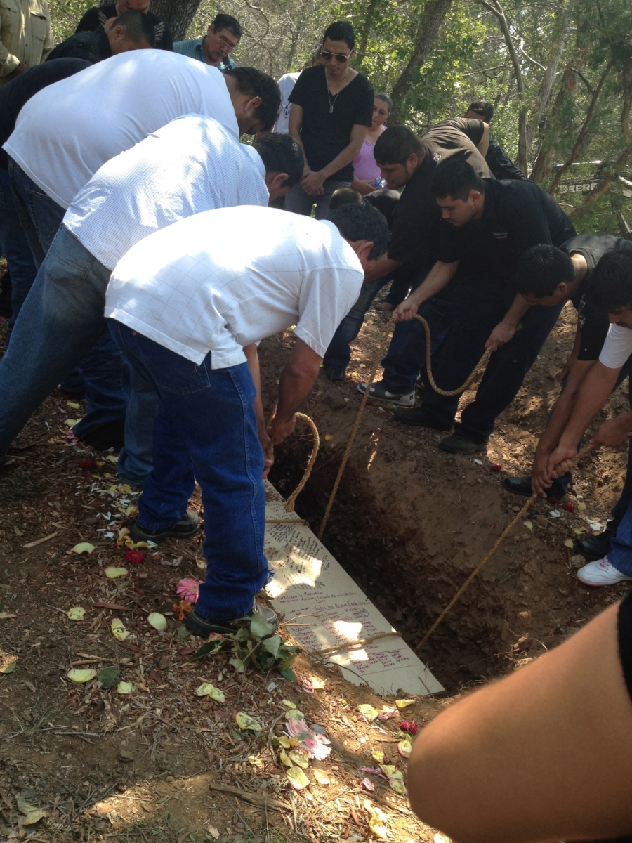 A family participating in a green burial, photo courtesy of Sarah Wambold.