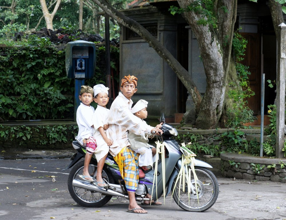 Don't try this at home kids: Balinese families often travel together on motorbikes, sometimes with up to 6 passengers!