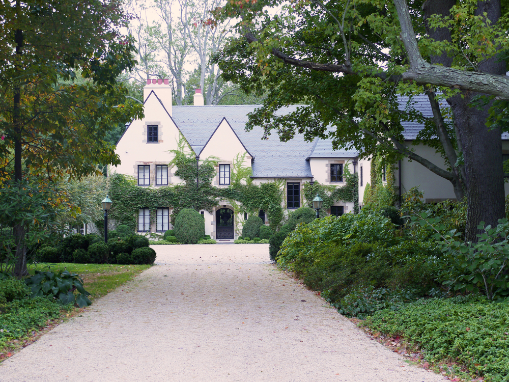A LANDSCAPE AND GARDEN IN LOCUST VALLEY