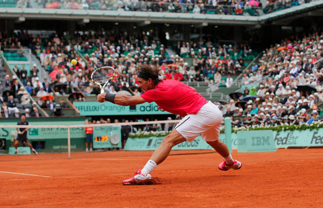 Rafael Nadal returns the ball during the 2012 French Open tennis tournament in Paris. (AP Photo/Christophe Ena)