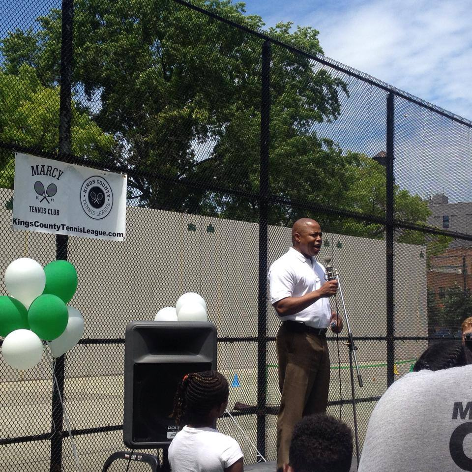 Brooklyn Borough President Eric Adams speaks at the ribbon cutting ceremony for the renovated Marcy tennis court.