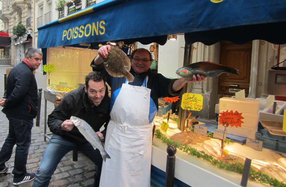 Choosing fish is fun at the French market.