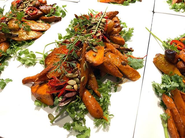 Tunisian roasted carrots - farm carrots roasted with Fresno chilies, kalamata olives, cilantro and harissa dressing.