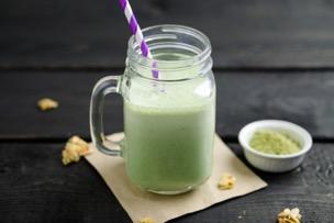 green smoothie with matcha tea in mason jar