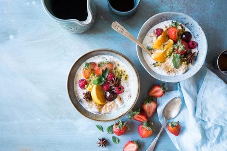 two bowls of creamy coconut breakfast quinoa