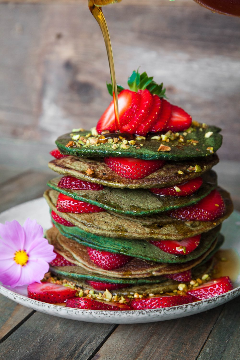 stack of matcha green tea pancakes with strawberries