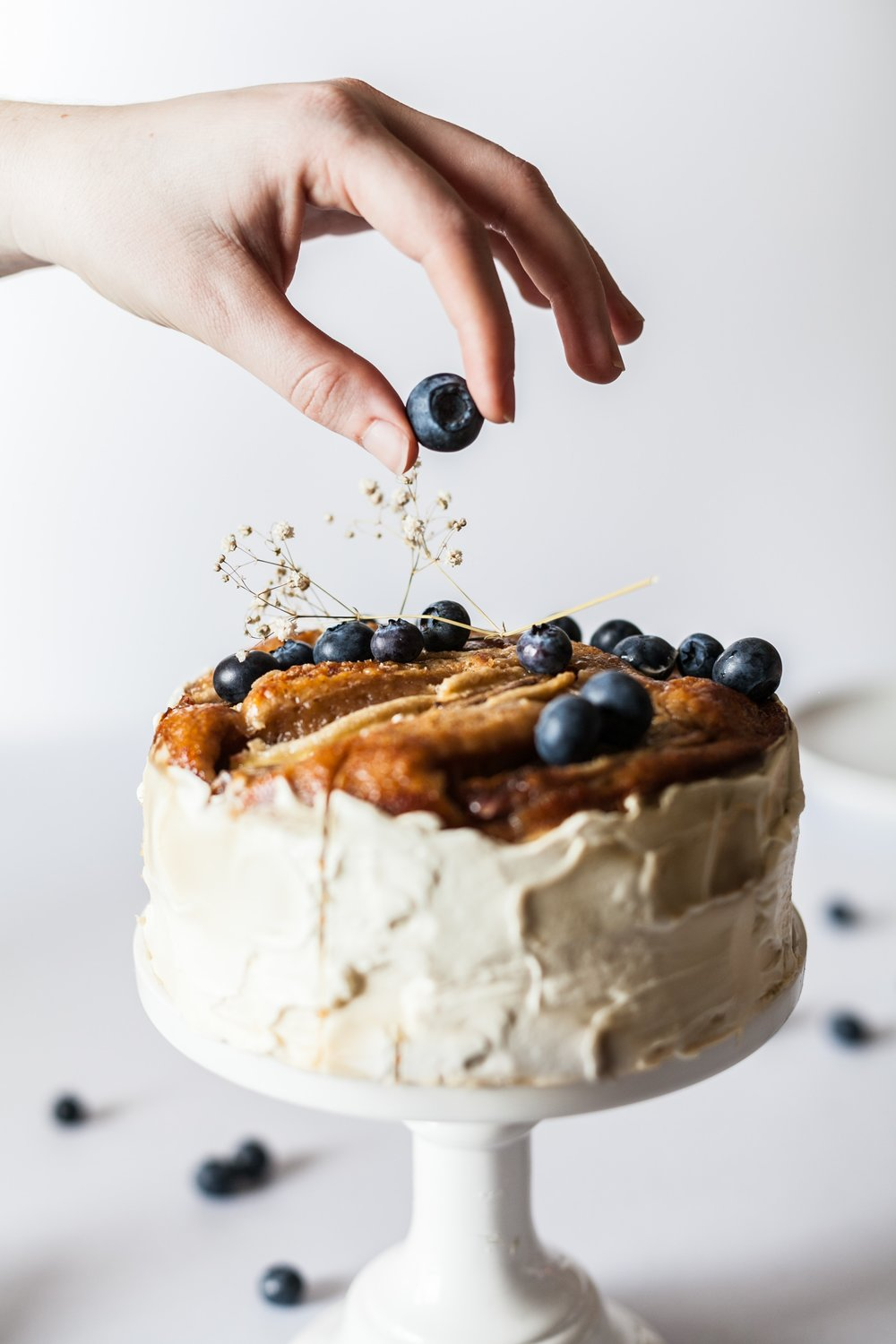 whole vegan ginger snap cake topped with blueberries