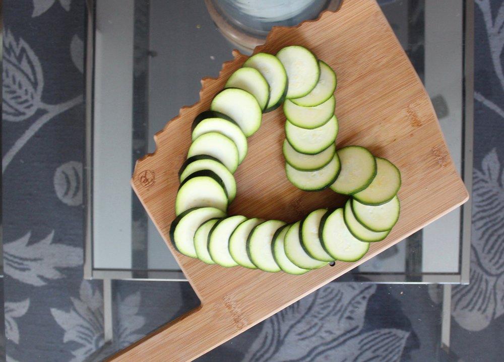 cucumber slices on wood cutting board