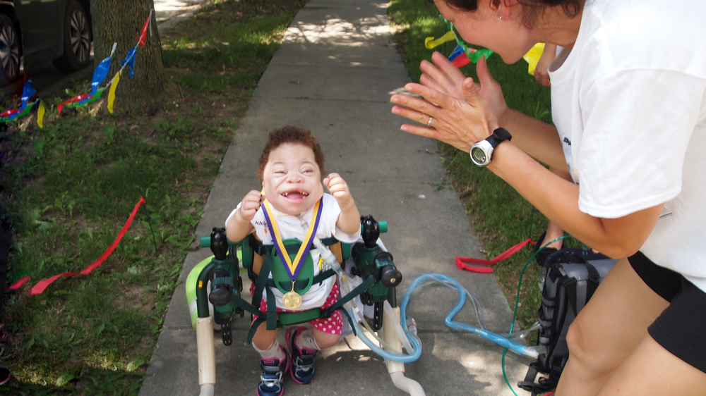 Proud and determined Indianapolis Achilles Kids member as she reachs the finish line