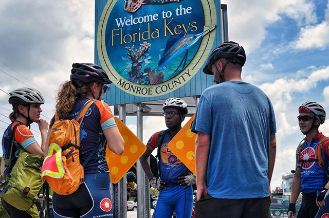"Don't let the excitement in their faces fool you -- we're officially on the Keys and are happy to be here! We had our first negative run-in with the police today which resulted in a written warning essentially for ""riding a bicycle properly on the road."" Regardless, our team is loving the coast and psyched for our last two days. 📷: @thegregarious  #pro8000 #patrickrideson #annerideson #adventurebybike #surlybikes #salsacycles #somafab #biketouring #pedalforever #worldbybike #roadslikethese #getoutstayout #sleepinthedirt #adventurecycling #floridaconnector #ortliebusa #brooksengland #cycleflorida #noarreststilkeywest"