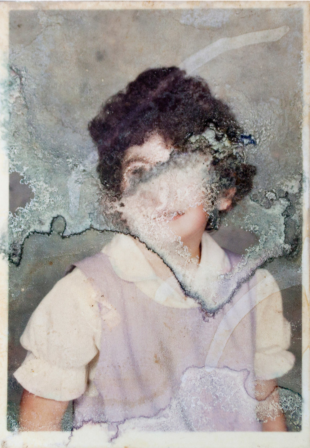 This found photo features one of the girls who testified in the sexual abuse trials of 2004. As a result the girl in the photo has been scrubbed out of Pitcairn history. This was the only image or physical trace of her that I found anywhere on the island. This had been stashed in the back of an album destroyed by water in the last remaining traditional dunnage house on Pitcairn, a house owned by a former culture teacher at the island school, from where this school photo originated.  Her face has been obscured and distorted, as though the physical environment of Pitcairn itself has slowly destroyed her, or erased her. In a sense this may be the most powerful image of my trip, drawing the parallel between Pitcairn's particular geography and some of the lasting effects on its people. When I left Pitcairn, I too felt emotionally destroyed – to leave the intensity behind was the greatest sense of freedom I have ever experienced.  From Big Fence / Pitcairn Island © Rhiannon Adam