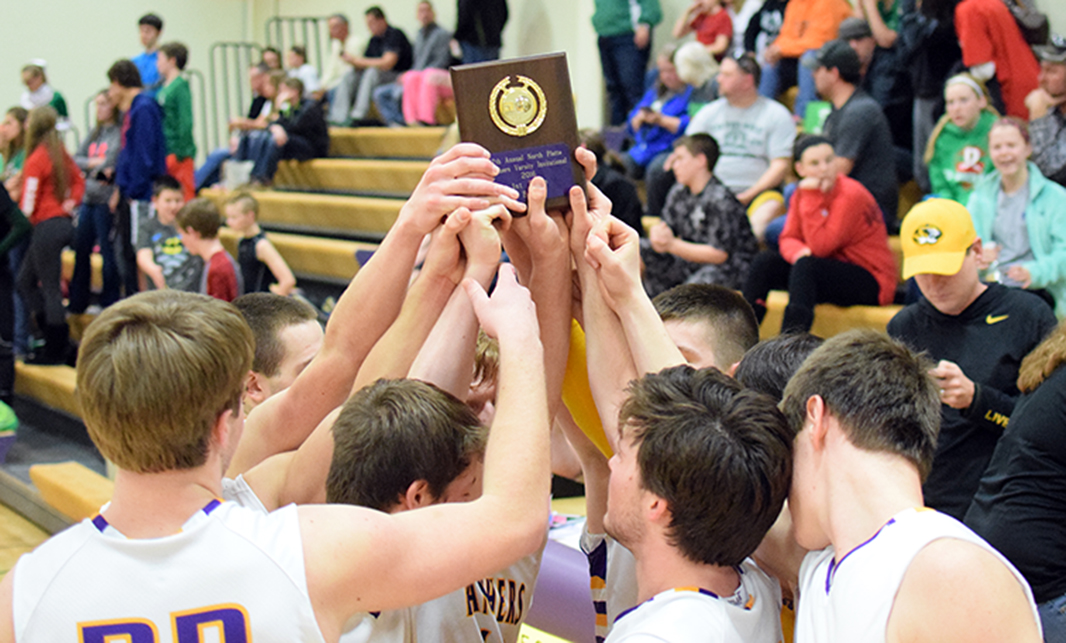 BRYCE MERENESS/Citizen photos Members of the North Platte boys basketball team hold up the first-place plaque after claiming the North Platte Invitational with a 46-42 win against Mid-Buchanan on Saturday, Jan. 30 at North Platte High School in Dearborn, Mo.