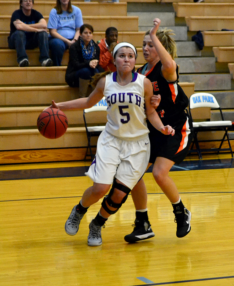 BRYCE MERENESS/Citizen photo Park Hill South guard Mackenzie Stout (5) drives to the basket against Platte County guard Lindsey Bogart on Monday, Jan. 19 at Oak Park High School in Kansas City, Mo. Park Hill South won the game 46-40.