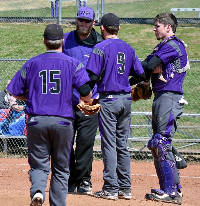BRYCE MERENESS/Citizen photo North Platte coach Grant Tysdahl, rear, meets with pitcher Blake Toliver (9), catcher Austin Shanks, right, and Jacob Stubbs during the North Platte Invitational on Saturday, March 28 at Dean Park in Dearborn, Mo.