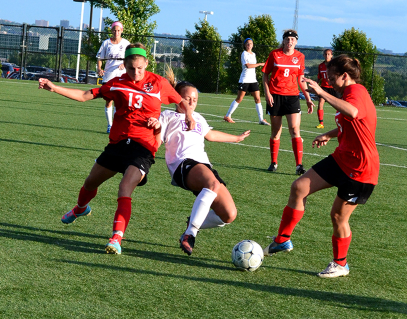 BRYCE MERENESS/Citizen photo Park Hill sophomore defender Jenna Winebrenner (13) fends off Park Hill South's Shay Jackson during a Class 4 sectional matchup Tuesday, May 26 at Park Hill District Soccer Complex in Riverside, Mo.