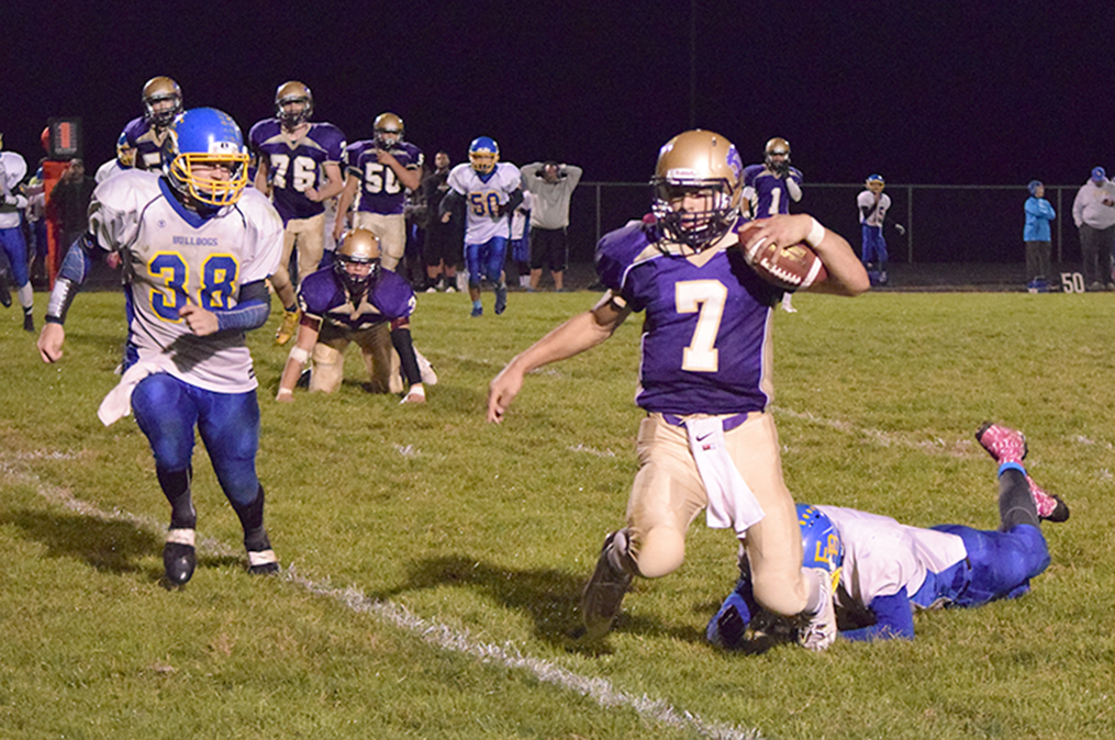 BRYCE MERENESS/Citizen photo North Platte senior quarterback Anthony Hernandez (7) is tripped up from behind during the Panthers game with East Buchanan on Friday, Oct. 2 at North Platte High School in Dearborn, Mo. East Buchanan won 32-8 after leading just 8-0 at halftime.