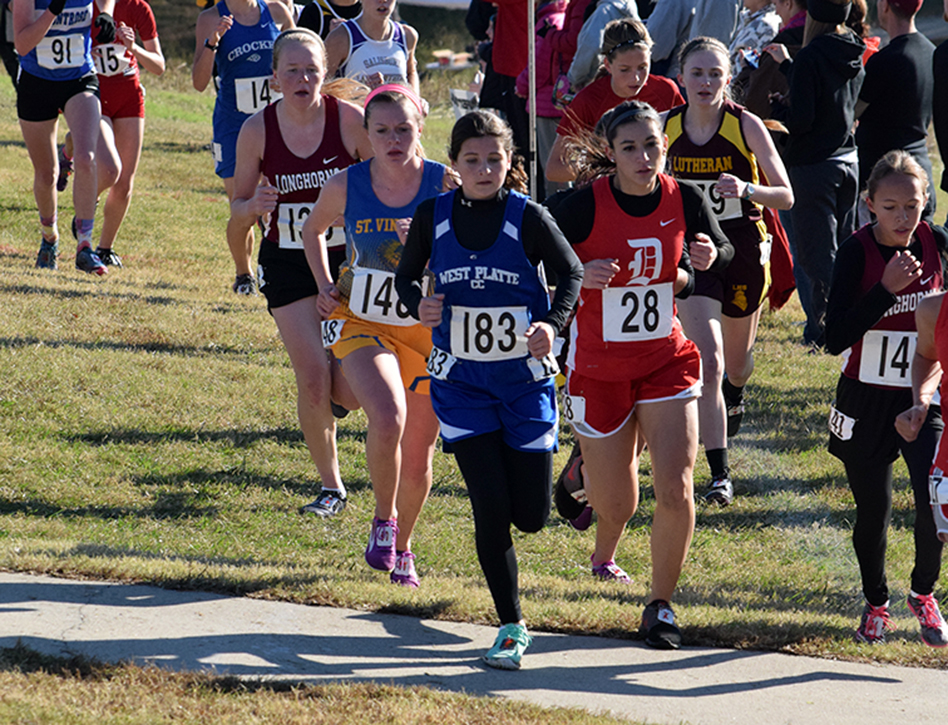 BRYCE MERENESS/Citizen photo West Platte freshman Lea Moose, right, sprints to the finish during the Class 1 Missouri State Cross Country Championships on Saturday, Nov. 7 at Oak Hills Golf Center in Jefferson City. Mo.
