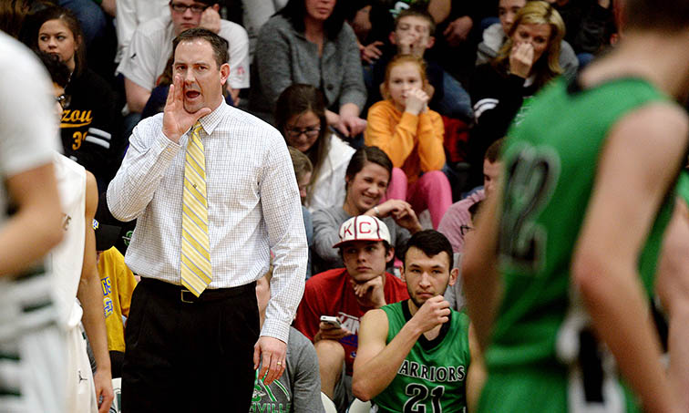 Smithville Warriors boys head basketball coach Chad Jones yells out to his players while playing Lafayette in St. Joseph Thursday night.