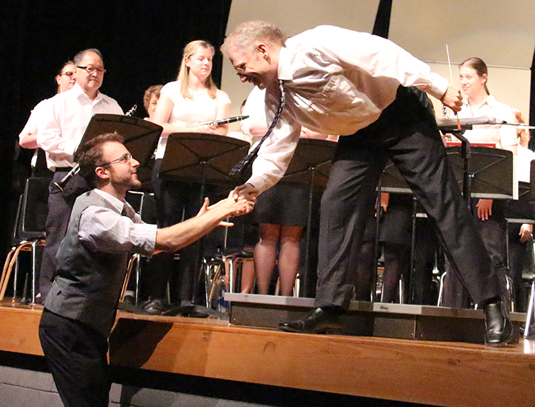 "ROSS MARTIN/Citizen photo Michael E. Anderson, left, shakes hands with Gavin Lendt, director of the Platte City Community band, during the Platte County 175th Anniversary Celebration finale event Oct. 26 at the Wilson Center for Performing Arts inside Platte County High School. Anderson composed an original musical piece entitled ""The Heart of the Land"" for the event, and the Platte City band and Parkville Symphonic Band joined up to play it and other selections at the concert."