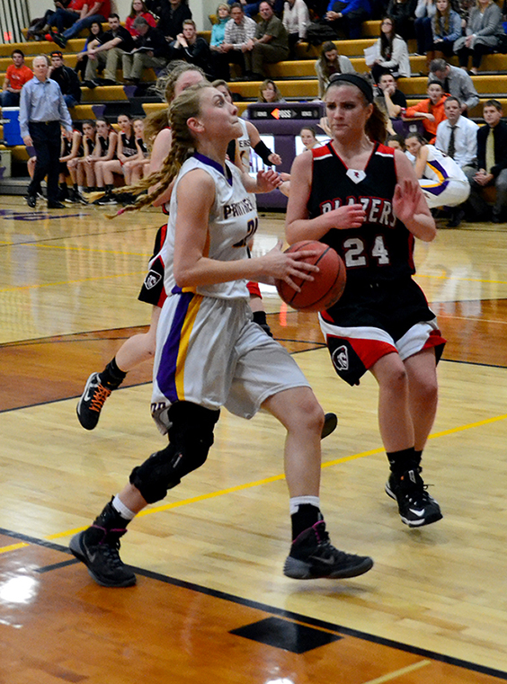 BRYCE MERENESS/Citizen photo North Platte guard Erin Manville, left, goes up for a layup against Northland Christian in a North Platte Invitational first-round game on Monday, Jan. 26 at North Platte High School.