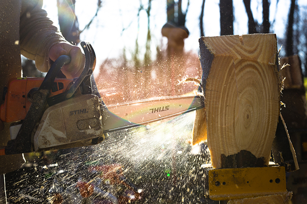 CORY MACNEIL/Citizen photo Sawdust flies as TJ Jenkins works in the sunlight on one of his carving projects.