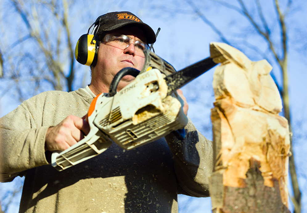 CORY MACNEIL/Citizen photo TJ Jenkins works on carving an owl with his chainsaw outside his home in rural Platte County.