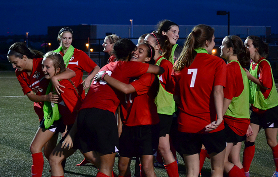 BRYCE MERENESS/Citizen photo Park Hill players celebrate Tuesday, May 26 at Park Hill District Soccer Complex in Riverside, Mo. after Bella Catano scored the winning goal in a 1-0 overtime victory against Park Hill South in a Class 4 sectional.