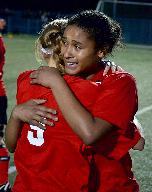 BRYCE MERENESS/Citizen photo Park Hill's Raena Woodruff, rear, hugs teammate Bella Catano after Catano scored the winning goal in a 1-0 overtime victory against Park Hill South on Tuesday, May 26 at Park Hill District Soccer Complex in Riverside, Mo.