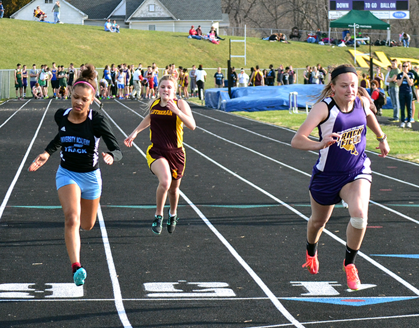 BRYCE MERENESS/Citizen photo North Platte senior Regan Nash, right, lunges for the finish line of the 100-meter dash ahead of University Academy's Jurnie Scott, left, on Monday, March 30 at North Platte High School in Dearborn, Mo.