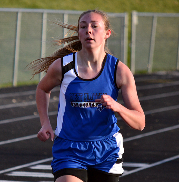 BRYCE MERENESS/Citizen photo West Platte junior Gretchen Hiatt competes in the 1,600-meter run. Hiatt finished fifth to help West Platte take home the second-place team trophy.