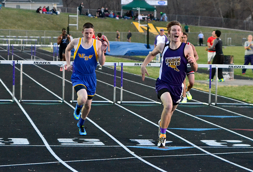 BRYCE MERENESS/Citizen photos North Platte senior Jerry Copenhaver, right, celebrates after crossing the finish line of the 300-meter hurdles during the North Platte Invitational on Monday, March 30 at North Platte High School in Dearborn, Mo.