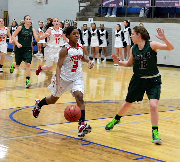 BRYCE MERENESS/Citizen photo Park Hill guard Gigi Hopkins, left, drives the lane against Staley's Maddie Ferrara during the Class 5 District 16 championship game on Friday, March, 6 at Central High School in St. Joseph, Mo.