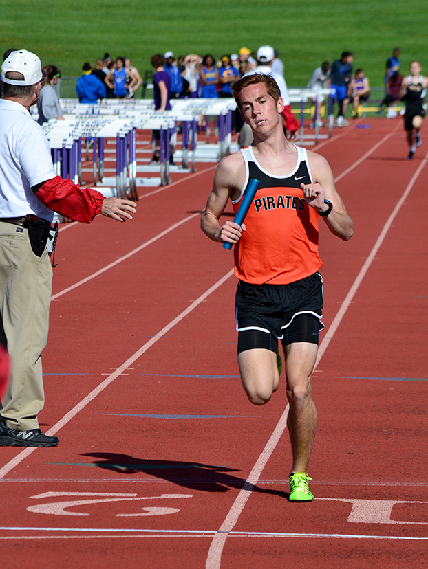 BRYCE MERENESS/Citizen photo Platte County senior Nathan Straubel crosses the finish line of the 4x800-meter relay at the Kearney Classic on Friday, April 10 at Kearney High School in Kearney, Mo. Straubel set a school record in the 3,200 later at the meet.