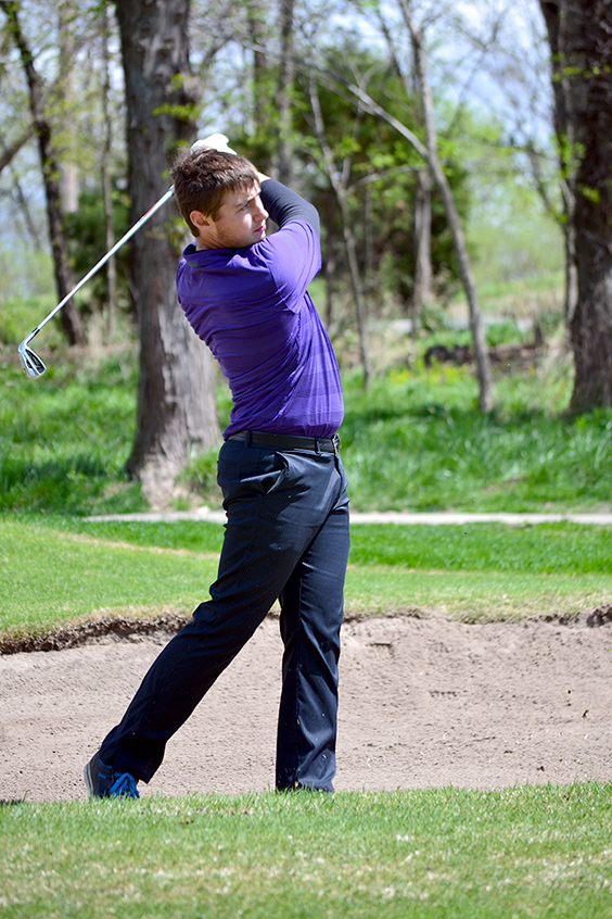 BRYCE MERENESS/Citizen photo Park Hill South junior Tanner Owen eyes an approach shot during the Liberty Invitational on Monday, April 20 at Shoal Creek Golf Course in Kansas City, Mo. Owen finished in third place with a 3-over round of 74.