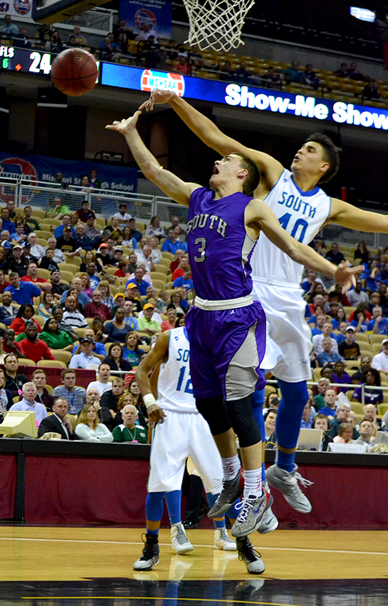 BRYCE MERENESS/Citizen photo Park Hill South guard Jacob Kline (3) has his shot blocked by Blue Springs South's Marcus Meyer in the Class 5 state championship game against Blue Springs South on Saturday, March 21 at Mizzou Arena in Columbia, Mo.