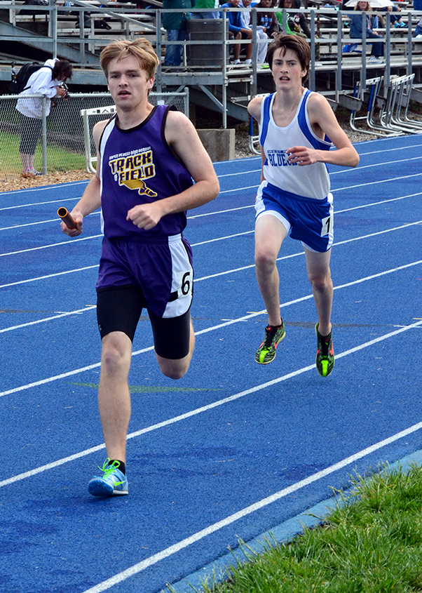 North Platte's Blake Romaker, front, runs ahead front of West Platte's Andrew Cicha in the 4x800 relay.