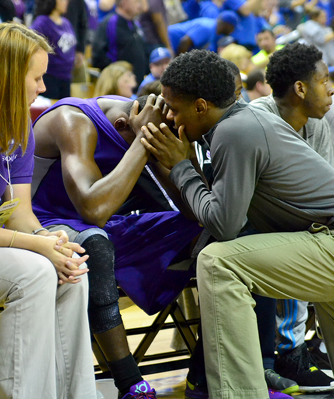 BRYCE MERENESS/Citizen photo Keith Richards, right, consoles Park Hill South guard James Byrd as the seconds tick down in the Panthers loss in the Missouri Class 5 title game against Blue Springs South on Saturday, March 21 at Mizzou Arena in Columbia, Mo.
