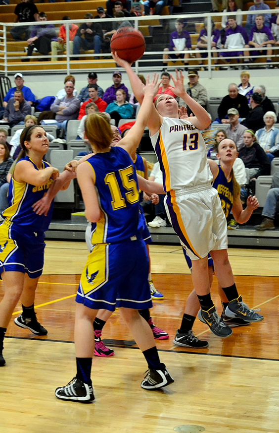 BRYCE MERENESS/Citizen photo North Platte guard Sarah Johnson (13) attempts a shot against Jefferson in the championship game of the North Platte Invitational on Saturday, Jan. 31 at North Platte High School in Dearborn, Mo.