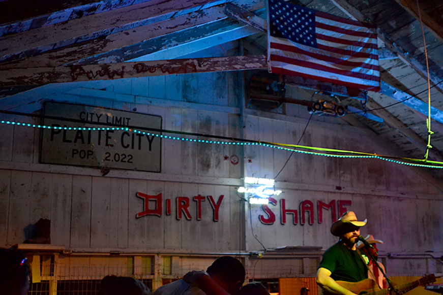 Outlaw Jim and the Whiskey Benders performed at The Dirty Shame Saloon on the Platte County Fairgrounds this past week. Fair board members voted Wednesday to take down a Confederate flag that used to hang next to the city population sign on the wall. The move came following questions from a Kansas City Star reporter.
