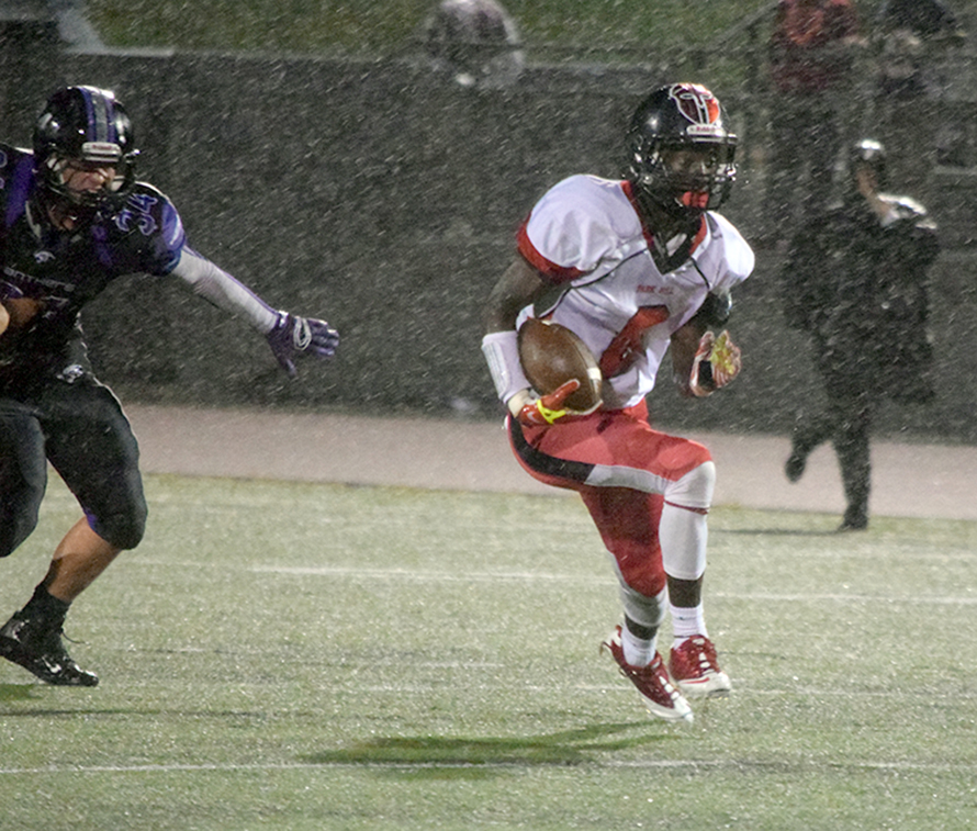 Park Hill senior wide receiver Kentrez Bell runs after a catch in the rain against Park Hill South on Friday, Sept. 19 at Park Hill District Stadium in Kansas City, Mo.