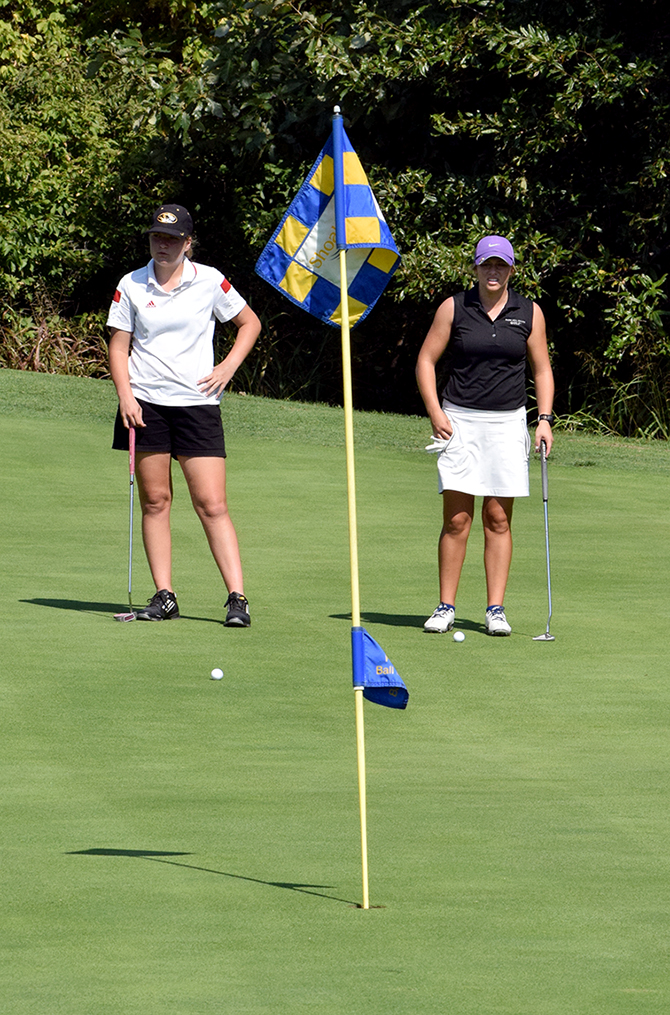 BRYCE MERENESS/Citizen photo Park Hill sophomore Kelbey Emerson, left, and Park Hill South junior Miranda Steczak look over putts on the par-3 No. 17 during the Class 2 District 8 Tournament held Monday, Sept. 28 at Shoal Creek Golf Course in Kansas City, Mo.