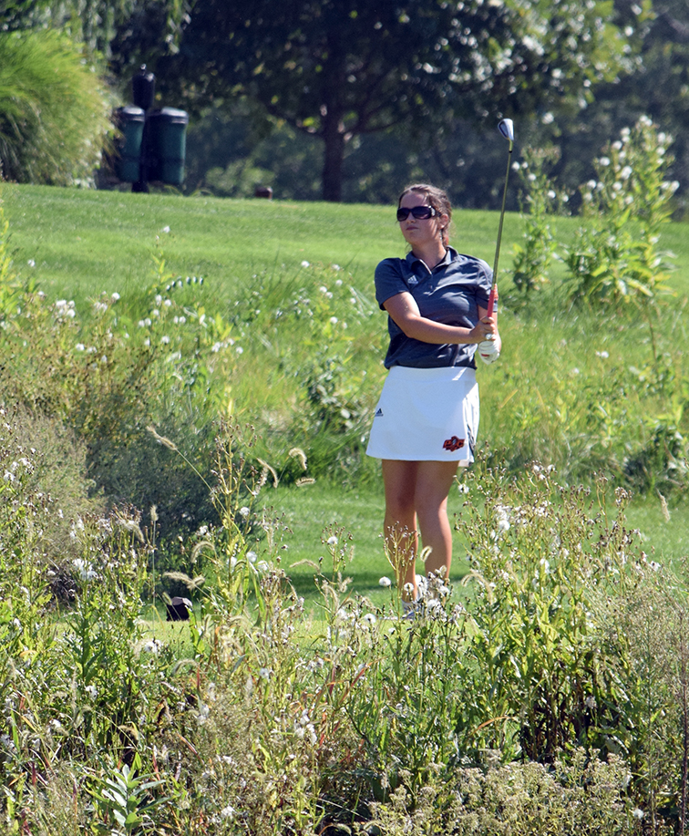 BRYCE MERENESS/Citizen photo Platte County freshman Jessalyn Shipp watches her tee shot on the par-3 No. 17 during the Class 2 District 8 tournament on Monday, Sept. 28 at Shoal Creek Golf Course in Kansas City, Mo.