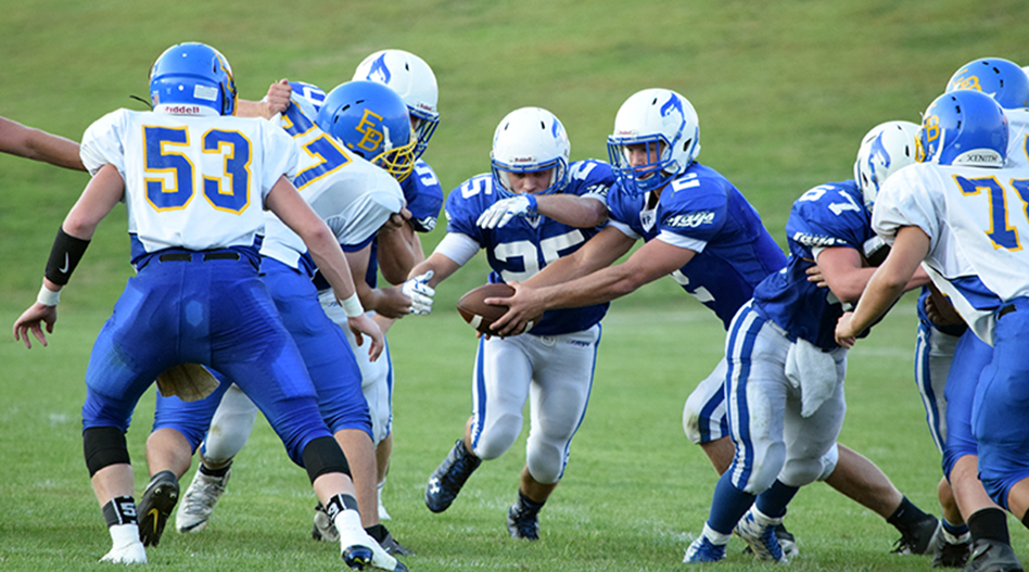 BRYCE MERENESS/Citizen photo West Platte running back Kyle Tabaka, center, takes the handoff from quarterback Brett Shaperdson (2) on Friday, Sept. 4 in the Bluejays game against East Buchanan at Rudolph Eskridge Stadium in Weston, Mo.
