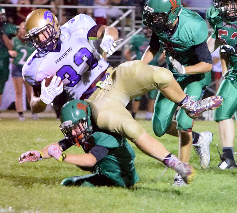 BRYCE MERENESS/Citizen photo North Platte senior running back Aron Burke is brought down by a Mid-Buchanan defender on Friday, Sept. 4 at Mid-Buchanan High School in Faucett, Mo.
