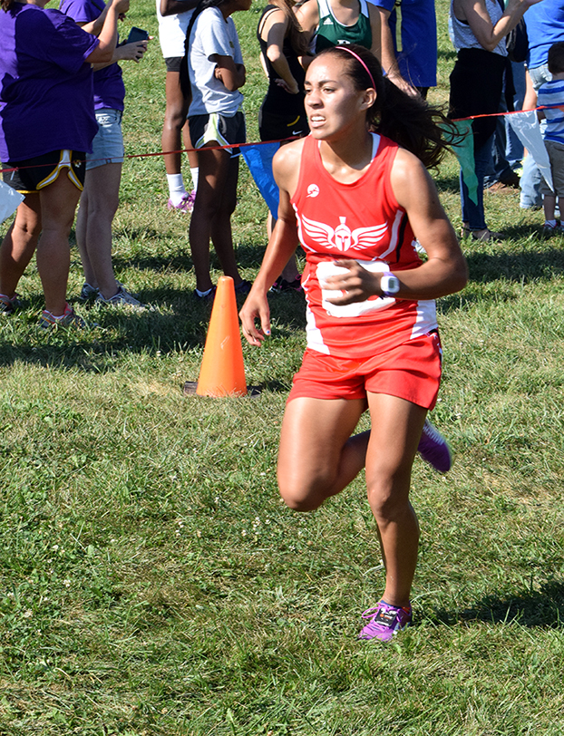 BRYCE MERENESS/Citizen photo Park Hill sophomore Chais Wright runs the course at the Liberty Invitational on Saturday, Sept. 6 at Stockdale Park in Liberty, Mo. Wright won the event for her first career win.