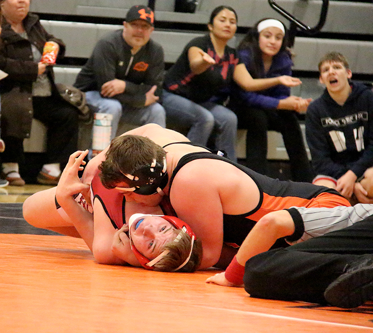 Platte County 195-pounder Adam Muelenbach works to pin Park Hill's Jacob Sobbing. Park Hill won the dual 37-20.